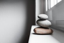 Close-up Of Zen Stacked Pebbles On Window Sill