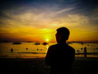 Silhouette Man Standing At Beach During Sunset