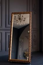 Luxurious Gold Floor Mirror In Dark Interior