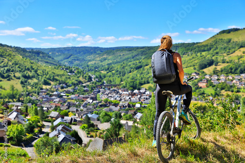 Fototapeta active woman biking countryside- Aveyron in France obraz