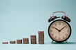 Leinwanddruck Bild Increase coins stack graph with alarm clock on blue background. Business investment time concept.