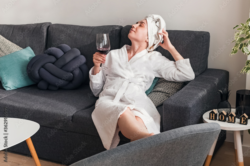 Fototapeta Young woman relaxing at home on weekend