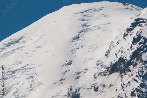 Mount Rainier With Tiny Climbers Descending