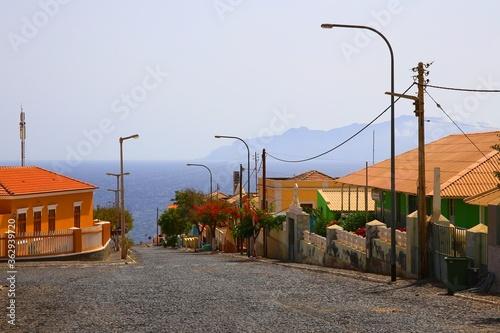 Canvastavla Street in Sao Felipe and view to Brava island, Cape Verde