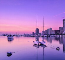 Sailboats In Marina Against Sky During Sunset
