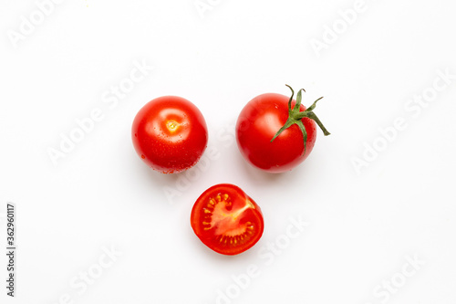 Canvas Print Fresh cherry tomatoes with water drop isolated on white background, top view, fl