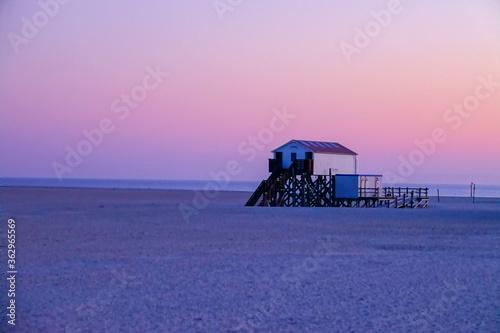 Canvastavla Lifeguard Hut On Beach Against Sky During Sunset