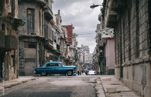 Fototapeta Cars On Street Amidst Buildings In City obraz na płótnie