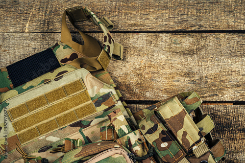 Military body armor on wooden background close up Wallpaper Mural