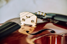 Violin Parts. Bow First On White Marble Background. Selective Focus.