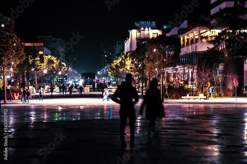 Wallpaper Mural People Walking On Illuminated Street At Night
