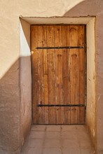 An Old Wooden Door On An Old Sandstone Wall In One Of The Old Towns
