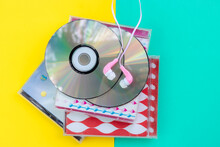Directly Above Shot Of Compact Discs On Colored Background