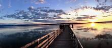 Pier Over Lake Against Sky Dur...