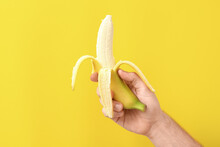 Male Hand With Ripe Banana On ...