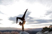 Woman Doing Handstand On Rock ...