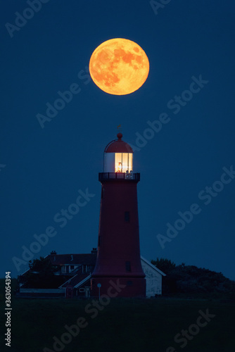 Obraz na plátně Low Angle View Of Lighthouse Against Sky At Night With Full Moon Above The Light