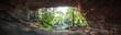 Leinwandbild Motiv Rock Formation Amidst Trees In Forest