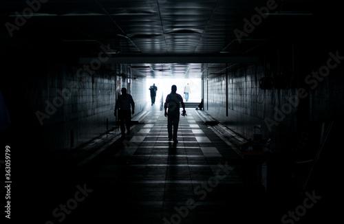 Tela People Walking In Underground Walkway