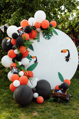 Children's photo zone with a lot of balloons. Decorations for a Birthday party. Concept of children's birthday party in a pirate style. Photozone for a pirate party, birthday party