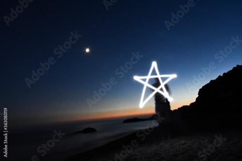 Carta da parati Low Angle View Of Illuminated Lighting Equipment On Beach Against Sky