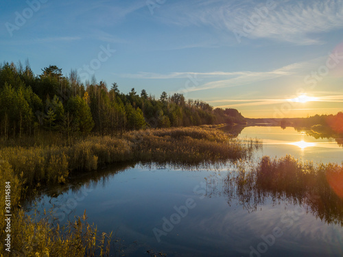 Foto Scenic View Of Lake Against Sky During Sunset