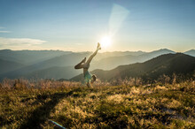 Woman Doing Handstand On Mount...
