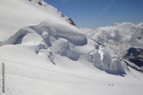 Vászonkép Silhouette Of Two Climbers Descending The Lys Glacier, Monterosa, Alps Italy