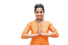 Beautiful South Indian Woman Doing Namaste Gesture While Looking At Camera, Isolated Over White Background