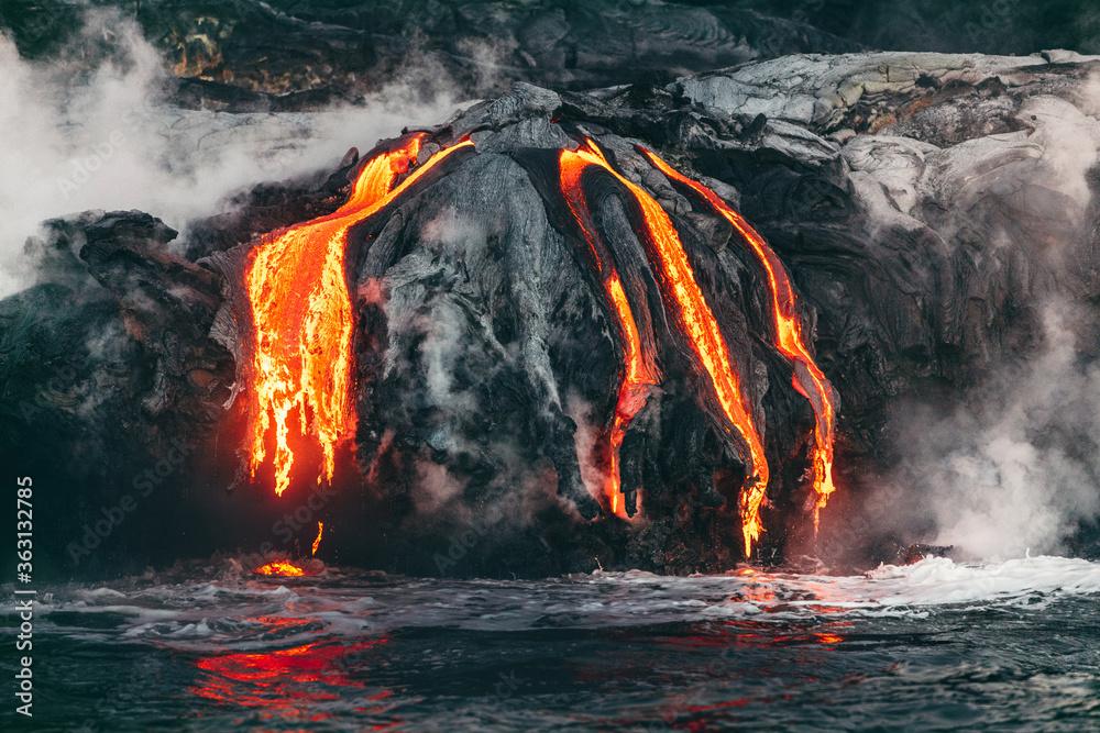 Fototapeta Active lava flow volcanic eruption magma touching the ocean in Big Island, Kilauea volcano, Hawaii.