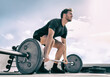 Gym fitness weightlifting deadlift man bodybuilding powerlifting at outdoor summer health club. Bodybuilder doing barbell weight lifting training workout with heavy bar.