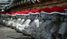 Sculptures With Knit Hats In Row
