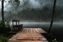 Wooden Footbridge Over Lake In Forest
