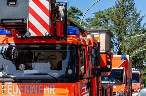 View Of Red Fire Engine On Street In City Fototapet