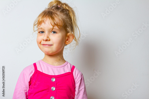 Portrait of sweet little girl as she is have comical face expression Canvas-taulu