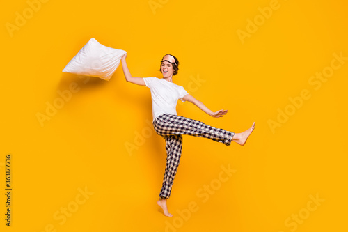 Fototapeta Full length body size view of her she nice attractive lovely crazy cheerful cheery girl dancing jumping having fun isolated on bright vivid shine vibrant yellow color background obraz