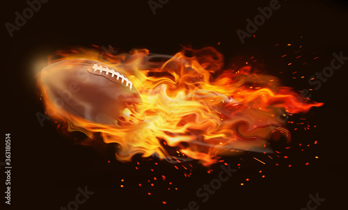 Fototapeta Rugby ball with bright flame flying on black background obraz