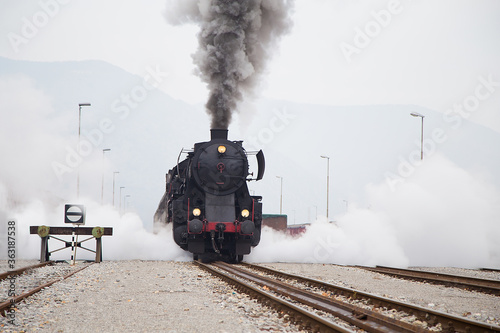 Fototapeta Old Steam train - locomotive is leaving the Railway Station at Nova Gorica, Slovenia obraz na płótnie