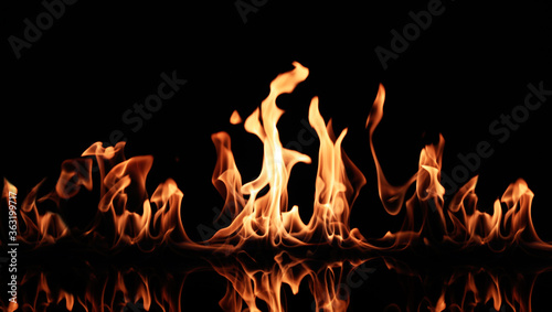 Beautiful bright fire flames on black background Wallpaper Mural