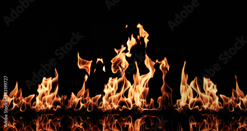 Beautiful bright fire flames on black background Canvas Print