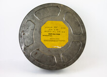 An Original Old Film Can With An Orange Label. For 16 Mm Film Rolls.