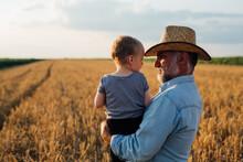 Farmer And His Grandson Walkin...