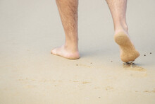 Male Bare Feet In The Wet Sand