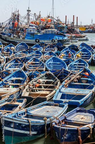Fotografiet Fishing Boats Moored At Harbor