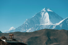 Small Building Near Muktinath Temple At Mustang, Nepal. Blue Sky Sunny Day And Everest Mountain On The Background.