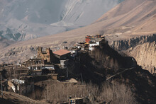 Small Village On Top Of A Hill Near Muktinath Temple At Mustang, Nepal. Sunny Day And Mountains On The Background.