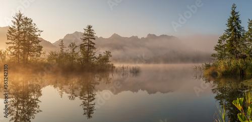 Fototapeta Reflection Of Trees In Lake Against Sky obraz