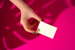 Leinwanddruck Bild - Female hand holding blank businesscard. Creative photo with shadow