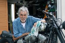 Senior With Motorbike