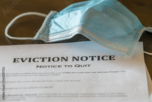 Defaulting renter with facemask receives letter giving notice of eviction from h Canvas Print